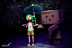 When you are around,even the rain tasted like sweets... (achew *Bokehmon*) Tags: light wallpaper love rain zeiss umbrella toy happy amazon sweet box sony sugar carl alpha figurine raining brolly strobe yotsuba danbo 2470 a850 danboard