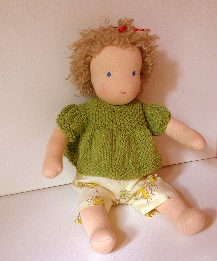 Mia's baby Sally in her summer shorts and knitted blouse
