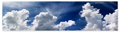 Dream of this as you outstretch your arms and pretend that you can fly. ([ Kane ]) Tags: city blue light sky sun white clouds canon office fluffy australia brisbane panoramic qld queensland kane 2470 gledhill 50d kanegledhill cloudpano kanegledhillphotography
