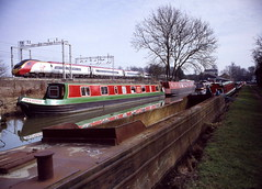film 33871 18032010 011 (Phil Grain) Tags: canal virgintrains narrowboats pendolino westcoastmainline wcml trentvalley rosenarrowboats brinklowmarina philgrain