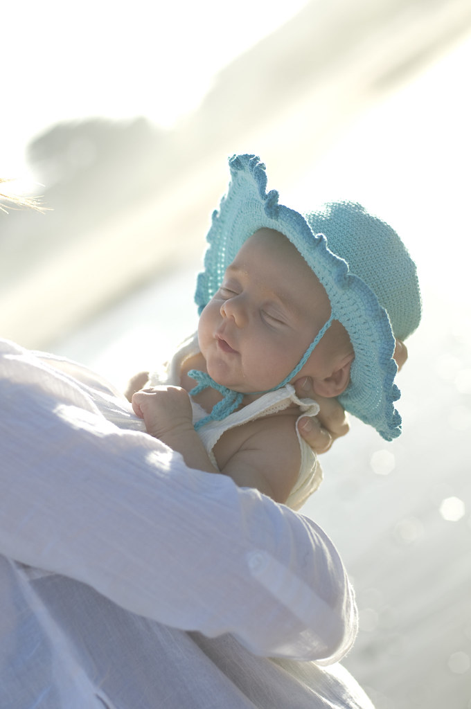 Baby in hat at beach