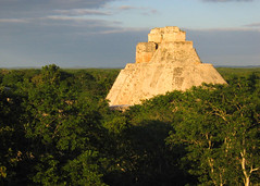 pyramid of the magician (Xuan Che) Tags: travel winter sunset sunlight history archaeology architecture mexico temple ancient ruins december pyramid maya yucatan award 2006 jungle merida tropical canonixus400 uxmal worldheritage prehispanic