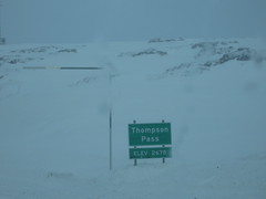 Sign for Thompson Pass: Elevation 2678 feet.