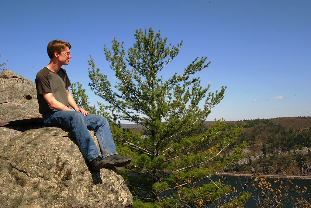 Me, enjoying the view while sitting on a steep cliff edge.
