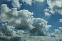 Puffy clouds loaded with rain, blue sky, from ...