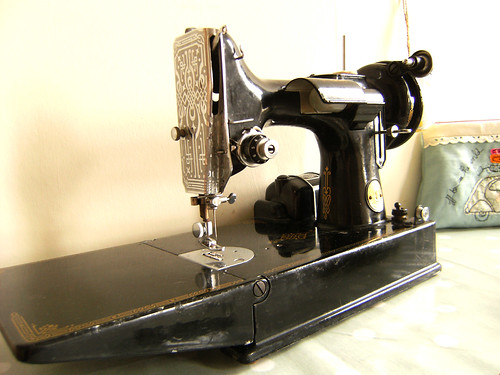 these two Singer sewing machines make...