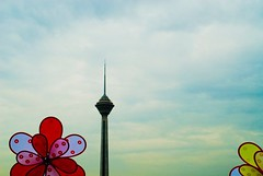 Kids vs men (kooshii) Tags: blue red cloud tower yellow clouds iran spin gig tehran  milad
