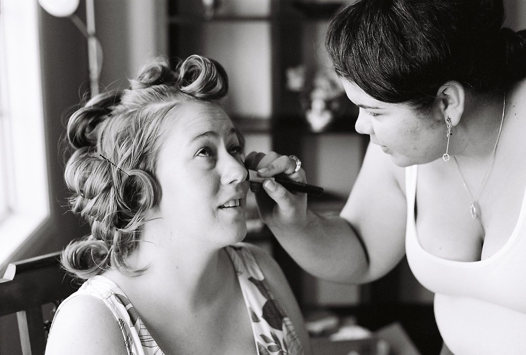 Griffith park wedding photography of bridal prep with makeup on 35mm film in black and white