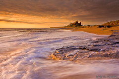 Bamburgh Castle (Azzmataz) Tags: sea sun seascape castle rock sunrise hall d northumberland bamburgh a ©2010 ©2010adhall