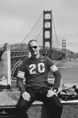 Carl in Sexy Button-fly Jeans on the Golden Gate Bridge in San Francisco (Blue Rave) Tags: sanfrancisco california bridge people blackandwhite bw male men guy face sunglasses sitting dude jeans goldengatebridge mate bloke abercrombieandfitch 2010 buttonfly meninjeans buttonflyjeans