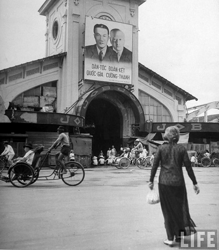 Saigon 1948 - French propaganda poster hanging on building, in French Indo China.
