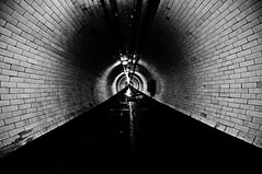 Under (Chris JL) Tags: uk blackandwhite bw london wet wall thames night river photo vanishingpoint greenwich rings claustrophobia greenwichfoottunnel underthethames nikond90 tokina1116mmf28 londonistriverproject chrisjl