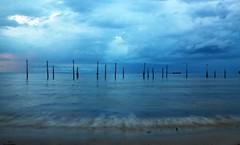 Blue Hue (Ahmad A Karim) Tags: rain sunrise waves moody blues uganda magichour lakevictoria rollingin entebbe