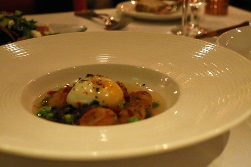 Chive Gnocchi and Morel Mushrooms; asparagus, garden peas, iberico ham, one hour egg, parmesan brodo