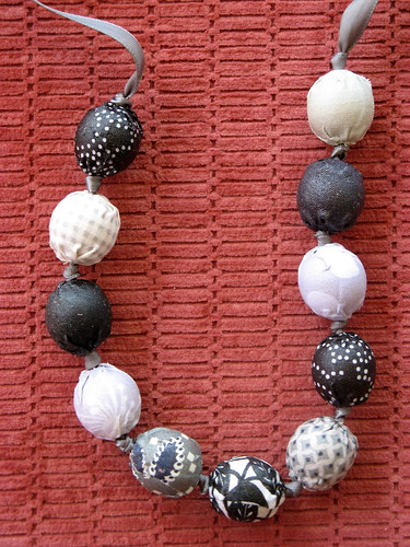 Fabric covered necklace detail of beads
