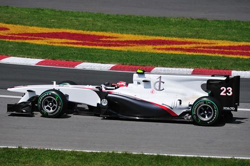 Kamui Kobayashi's Sauber C29 in the Senna corner of the Gilles Villeneuve Circuit