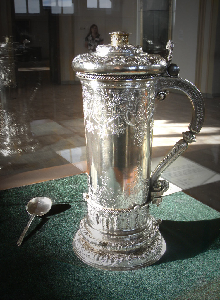 A silver stein for wine and a spoon