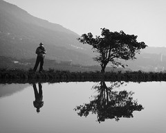 still life with men & trees (dr.milker) Tags: bw blackandwhite reflection man tree nature pool scenery noiretblanc blancoynegro 台灣 黑白 倒影 池塘 人 樹 風景 taiwan sanzhi 三芝