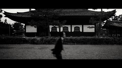 Kennin-ji Temple, Kyoto, Japan (emrecift) Tags: candid portrait street running blurry slow shutter temple japan analog 35mm film photography bw monochrome cinematic grain 2391 anamorphic crop canon ae1 program new fd f28 kodak tmax 100 ilfosol 3 114 emrecift filmdev:recipe=11479 kodaktmax100 ilfordilfosol3 film:brand=kodak film:name=kodaktmax100 film:iso=100 developer:brand=ilford developer:name=ilfordilfosol3