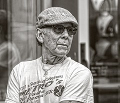 16 year old t-shirt..... (Kevin Povenz Thanks for the 3,200,000 views) Tags: 2017 june kevinpovenz westmichigan michigan holland hollandstreetperformers ottawa ottawacounty portrait blackandwhite bw male man had old tshirt sunglasses glasses canon7dmarkii face wrinkles