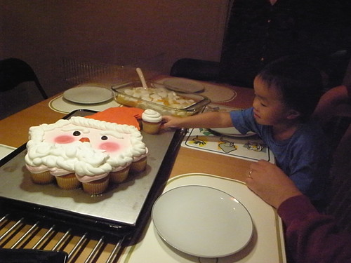 Josh reaches for cupcake Santa
