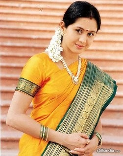 Tamil actress Devayani in yellow saari