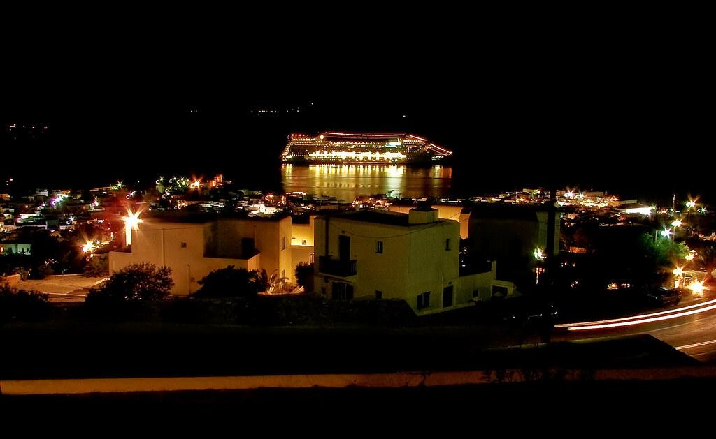 Mykonos at night with cruiseship