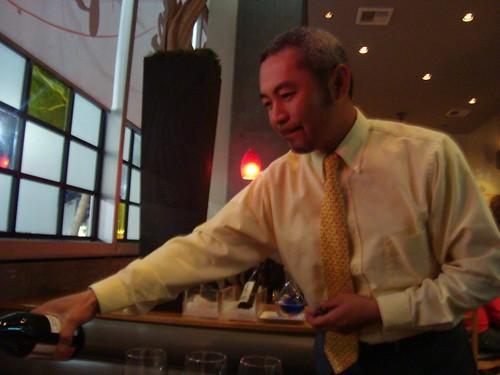 Yuji Matsumoto pouring sake