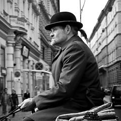 The Viennese Coachman (gabbelunkan) Tags: viennese mariahilf urban ponytail town city horsetrailer blackandwhite man vienna austria bw coachman hat