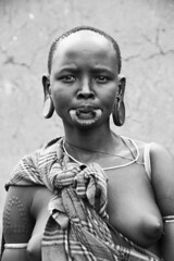 Mursi woman in Jinka, Ethiopia (Izla Kaya Bardavid) Tags: africa portrait people blackandwhite woman face rural photo nikon traditional tribal omovalley ethiopia tribe ethnic mursi afrique jinka mursitribe mursipeople