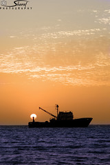 (Shrf AlMalki..) Tags: sunset sea beach silhouette boat ship sight     shrf   almalki
