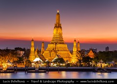 Thailand - Sunset behind Wat Arun (Temple of the Dawn) in Bangkok (© Lucie Debelkova / www.luciedebelkova.com) Tags: world city trip travel sunset vacation holiday building tourism architecture night sunrise thailand outside religious temple lights scenery asia southeastasia tour exterior place sundown outdoor dusk bangkok buddhist faith capital religion scenic cities structures belief sunsets kingdom buddhism visit location tourist structure architectural journey thai temples destination spirituality traveling sunrises southeast visiting exploration siam fareast scenes watarun touring scenics attraction arun beliefs beliefsystem southeasternasia beautynature templedawn architecturalexterior luciedebelkova subregionofasia wwwluciedebelkovacom