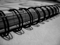 Bound (denizon51) Tags: macro metal paper spiral book shadows pages holes rings bound edges