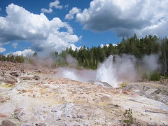 This is Steamboat Geyser splashing around in various minor eruptions.  Both photos are from the lower platform.