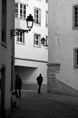 Walk Away (wicks_photo) Tags: street light shadow people white black men lamp monochrome wall gradient