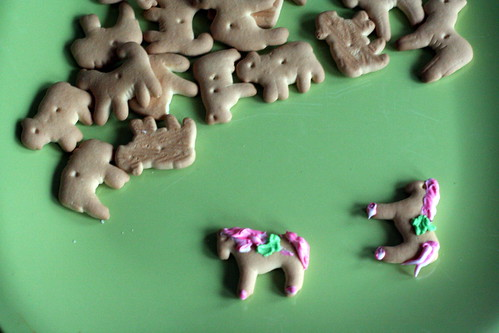 in the process of decorating the animal cookies