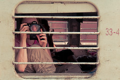 Behind Bars/33-4 (christian.senger) Tags: travel family portrait people woman india girl station digital train geotagged grey nikon bars asia photographer dof hand steel gray goa platform bahnhof wife departure lightroom d300 d5000 christian_senger:year=2010