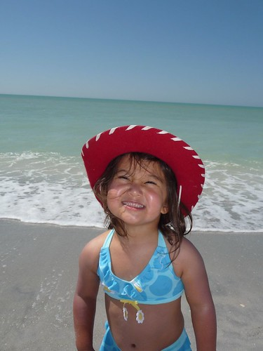 ava loving the beach.