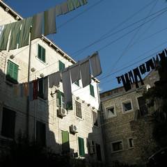 living in Split (Helen Boronia McHugh) Tags: blue windows sky green lines stone garden squares croatia laundry split washing 5photosaday