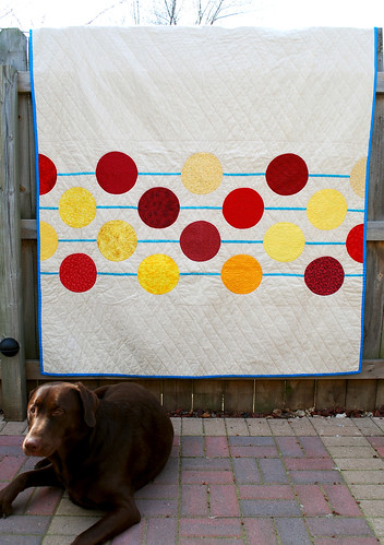 someone wanted his picture taken with the new quilt