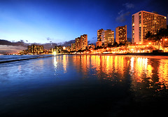 Waikiki Blue Hour (` Toshio ') Tags: ocean city longexposure blue sunset orange water architecture night clouds buildings reflections hawaii hotel sand colorful cityscape nightshot pacific waikiki oahu dusk wave hawaiian honolulu ripples bluehour aloha mahalo toshio