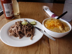 1/4 pound of pork shoulder and cheese grits (rabidscottsman) Tags: wood food white green fruit flesh table lunch pig silverware plate fork bowl meat pork eat citrus lime hotsauce grits oink basra hominy grandavenue porkshoulder cheddarcheese saintpaulminnesota limewedge scotthendersonphotography