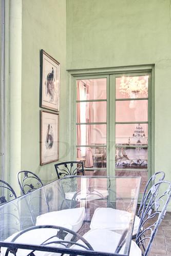 Through glass door in green rm