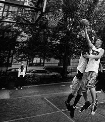 Untitled (RogelSM) Tags: park street nyc people bw newyork basketball chinatown afternoon play outdoor spectator