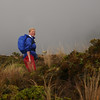 Woman hiking with daypack and rain gear NZ (!.Keesssss.!) Tags: newzealand people grass weather standing square outdoors photography day adult hiking adventure tongarironationalpark cheerful exploration discovery stormcloud adultsonly oneperson gettyimages blondhair toothysmile royaltyfree onewomanonly leisureactivity matureadult threequarterlength northislandnewzealand onlywomen waterproofclothing onematurewomanonly 4549years theflickrcollection keessmans 132ksgetty