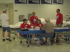 Most (?) of the committee (funny strange or funny ha ha) Tags: blue school red white oklahoma reunion t table town memorial day all weekend name small shirts badges fabulous ok hooker committee registration panhandle 2010