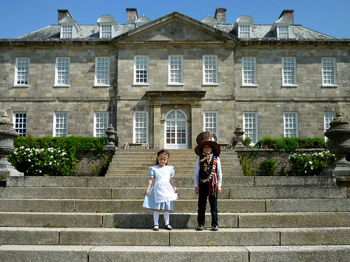 Alice and the Hatter on the steps at Anthony House