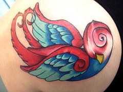 red swallow (*** coleyB ***) Tags: blue red tattoo swallows birdtattoos tatttoos suntattoo swallowtattoos redandbluetattoos