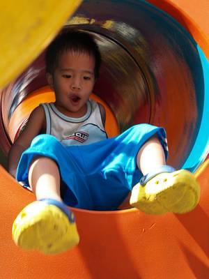 Julian in playground tunnel