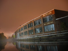Lowell Canals - Fog & Ambient Light (sixty8panther) Tags: city pink windows orange reflection building brick mill water beautiful fog stone night canon buildings river town canal haze model long exposure skies factory power shot map lock massachusetts pipes foggy peach down calm h2o powershot creepy historical waters serene hazy length pinksky geotag lowell s30 shutterspeed fstop longexposures focal sooc merimack